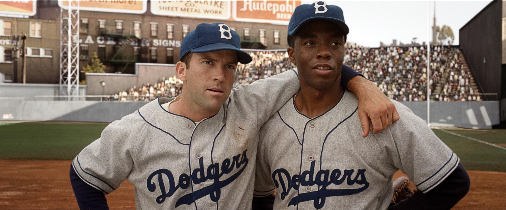 the movie 42 42, the movie about jackie robinson, includes a ton of middle-aged white guys  that you'll recognize from random tv shows.