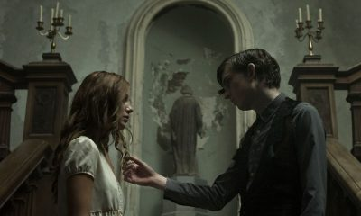 Bill Milner and Charlotte Vega in The Lodgers