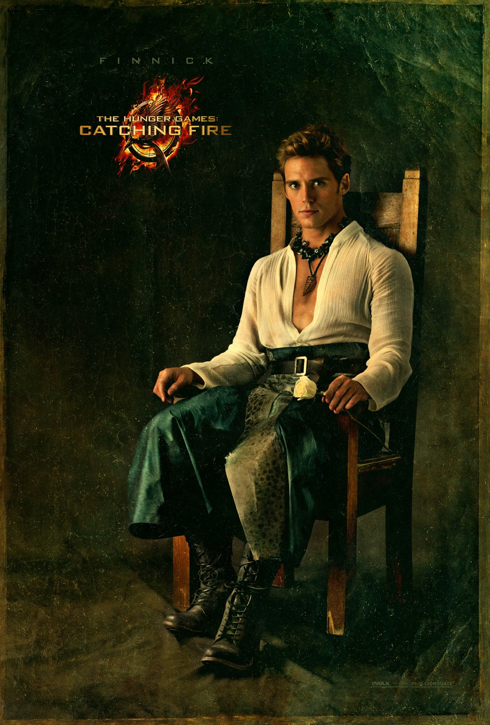 Catching Fire Finnick Character Poster Three More Catching Fire Posters Featuring Johanna, Finnick and Beetee
