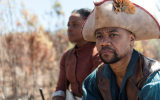 Cuba Gooding Jr. and Aunjanue Ellis in The Book of Negroes