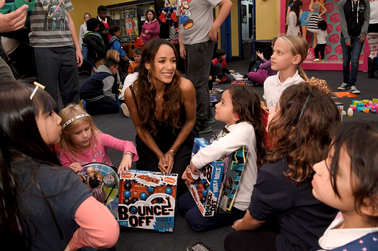 Dania Ramirez with kids at Boys & Girls Club of Burbank & Greater East Valley.