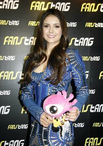 Nina Dobrev Shines in Herve Leger by Max Azria Ensemble in Shanghai