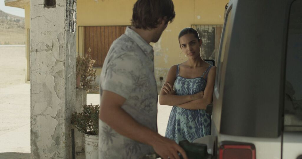 Shawn Lock and Paulina Gaitan in Crossing Point