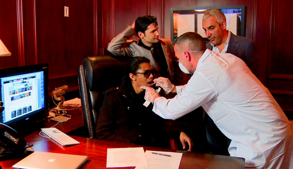 B Howard getting a swab for DNA testing as Corey Feldman and FilmOn CEO Alki David stand by